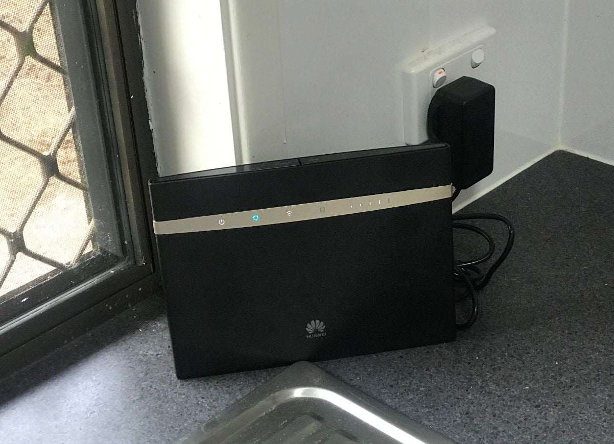 A wireless modem plugged into a wall