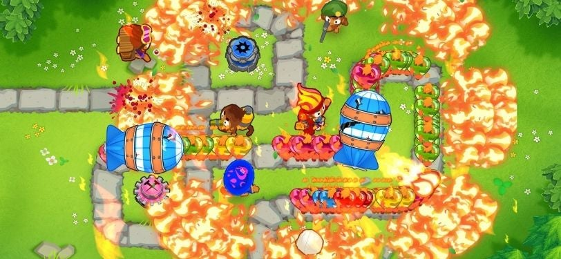 A screenshot from the game Bloons TD 6, where you're tasked with defending a map by popping balloons using an army of monkeys