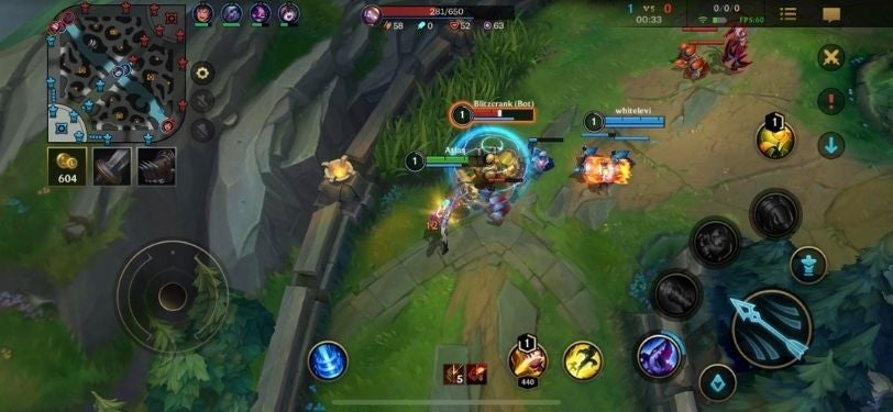 A screenshot from League of Legends: Wild Rift, where two teams of five players fight for dominance on a map