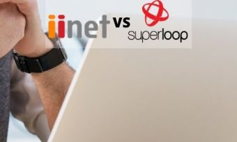 A person using a laptop, behind the iiNet and Superloop logos