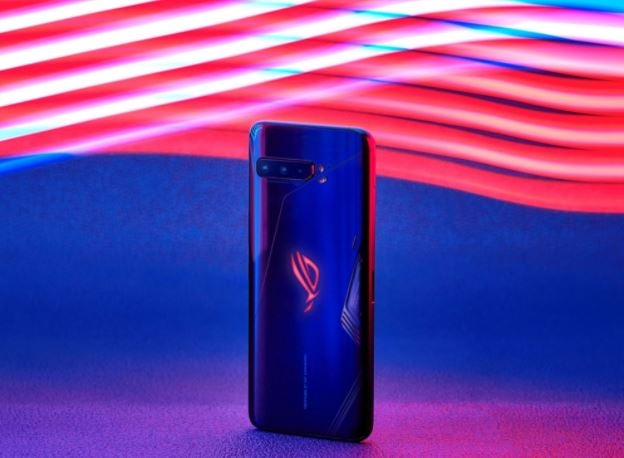 The ROG Phone 3, standing up, in front of a multicoloured background
