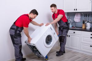 Men moving washing machine