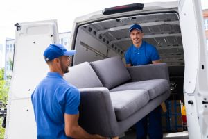 Removalists carrying couch