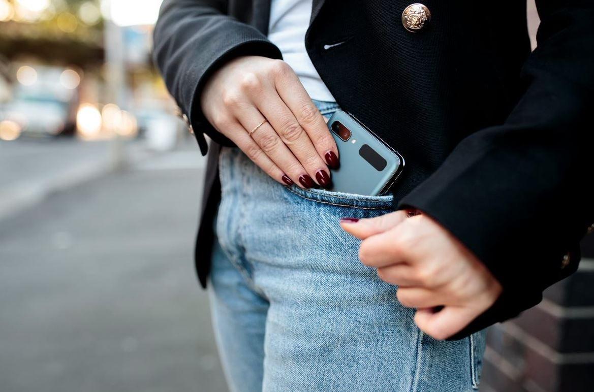 Flip phone folded in pocket