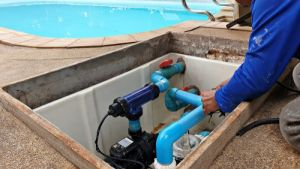 Technician fixing pool pump