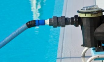 Pool pump operating in pool