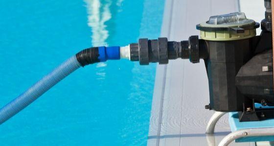 Pool pump operating in pool
