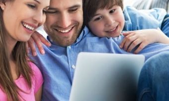 A family using a laptop all at once