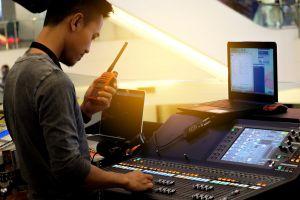 Sound engineer using walkie-talkie
