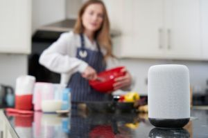 Cooking in kitchen with smart speaker