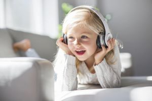 Child listening to music on headphones