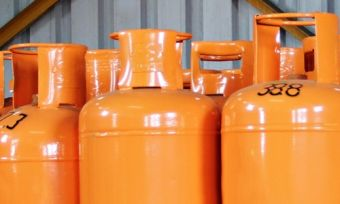 Orange LPG gas cylinders lined up