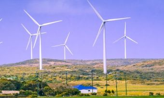 Wind turbines on hillside on farm