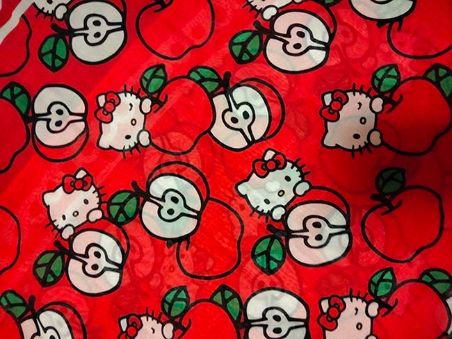 A bright red Hello Kitty scarf