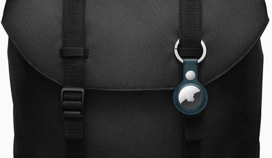 Apple AirTag in keyring attached to black bag