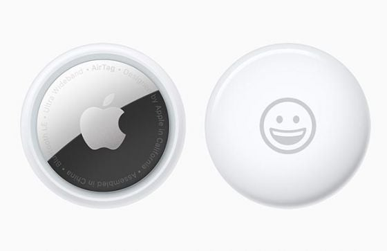 Front and back of Apple AirTags not in keyring holder