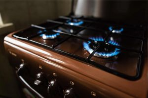 Gas stovetop with blue flame