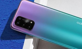 OPPO A54 5G phone in purple colourway leaning on book with blue cover