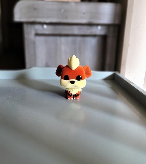 Portrait photo of Growlithe Pokemon figurine