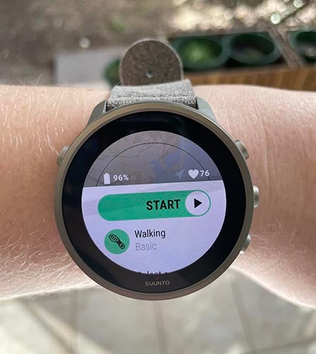 Person wearing Suunto 7 Titanium watch showing exercise mode