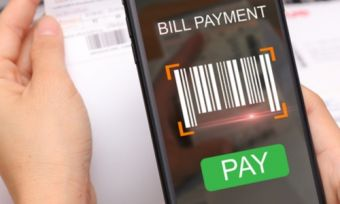 Person paying utility bill with mobile phone
