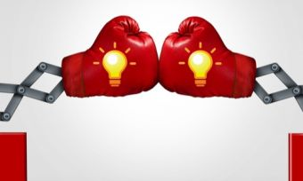 Boxing gloves with light bulbs representing a price contest