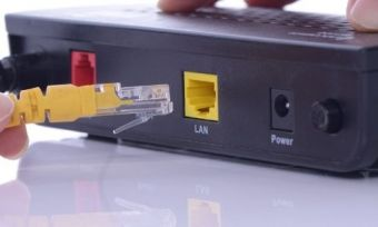 An NBN modem having an ethernet cable plugged into it