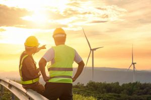 Workers looking at wind turbines