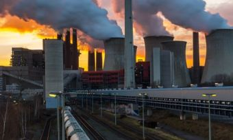 Coal fired power station operating at sunset