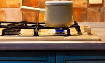 Cooking pot on gas stove top in kitchen
