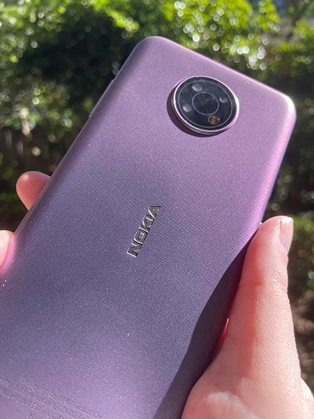 Closeup of back of purple Nokia G10 being held
