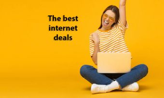 Woman sitting cross-legged with laptop, celebrating a good deal