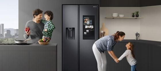 Samsung fridge in kitchen with a family