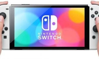 A person using the Nintendo Switch OLED Model