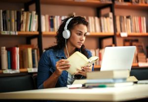 Female student studying online in library