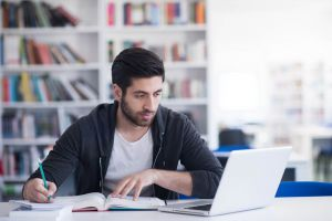 Male student studying online