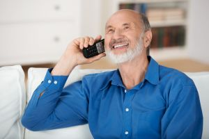 Man talking on cordless phone