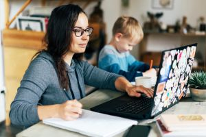Mum studying at home with child