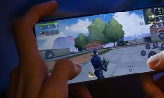 Closeup of person playing game on OPPO A94 5G phone