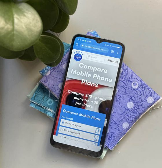 Screen of Realme C21 phone styled with fabric and pot plant