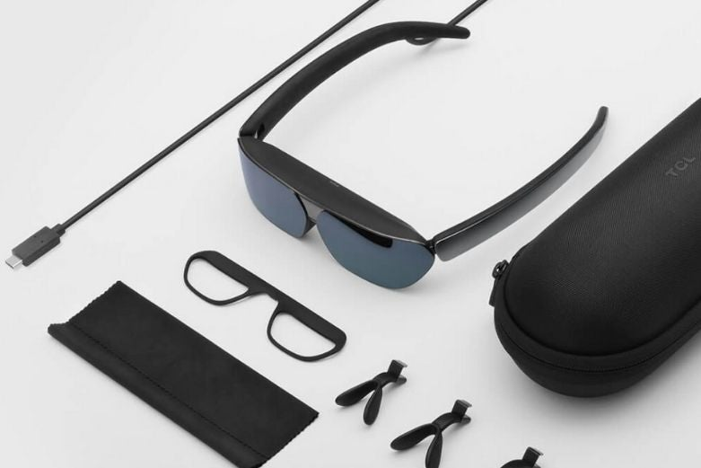 A pair of TCL Smart Glasses and accessories