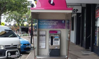 A Telstra phone booth on a town street