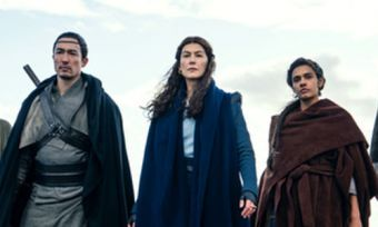 Still of seven characters standing together from The Wheel of Time Amazon show