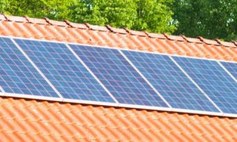 Solar panels on Australian roof with trees in background