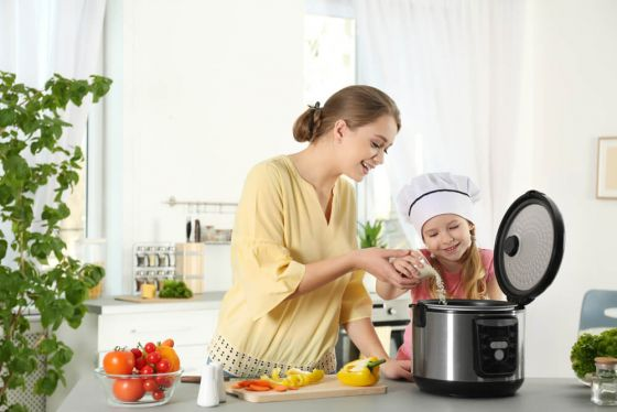 Mum and daughter use a rice cooker
