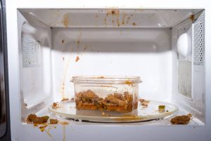 Dirty microwave with food spills