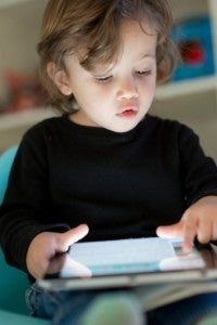 Young boy using tablet