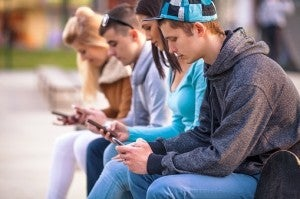 Teenagers with phones