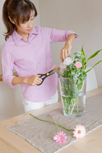 Woman trimming flowers