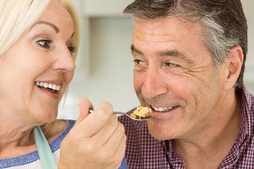 Woman feeding man